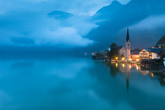Hallstatt at Dawn (baddoguy) Tags: mountain reflection fog austria twilight images getty hallstatt traveldestination