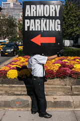 Armory Parking (mookie.nyc) Tags: parking candid street streetphotography sign holdingasign sonyrx1rii sony sonyrx1r2 35mm nyc newyorkcity newyorkers hide hidden dailylife working work streetportrait streetcharacter noface faceless nohead headless