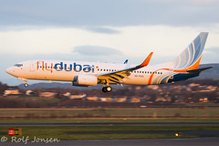 A6-FGG Boeing 737-800 Flydubai Glasgow airport EGPF 29.11-16 (rjonsen) Tags: plane airplane aircraft arrival approach delivery flight flying golden light hour panning