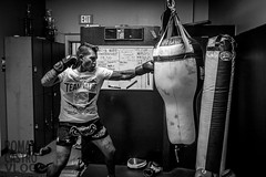 Francisco Garcia 10-25-16-2 (romancastro) Tags: muay thai muaythai blackandwhite kickboxer fighter gym training sandiego valormuaythai bnw x100t fujifilm photojournalism thephotoessay photoessay trainer boxing kick punch grit boxer striker tattoo