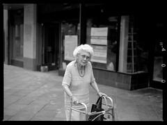 isn't she lovely (film) (jeff_tidwell) Tags: candid street streetphotography streetphoto film filmisnotdead analog medumformat blackandwhite denver elderly woman walker