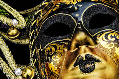 Behind the Mask (Carolyn Marshall Photography) Tags: mask carnival gold mardigras mardigrasmask carnivalmask texture eyes colorful fun mysterious black golden carnevale carnevalemask venice italy venetian fantasy beautiful ornate glittery glitter photography fineart artistic masks behindthemask marshall tampaphotographers floridaphotographers carolynmarshall