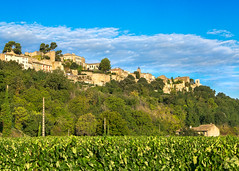 Menerbes (docoverachiever) Tags: bluesky provence building scenery rural landscape walls luberon vineyard hilltop france menerbes countryside town clouds