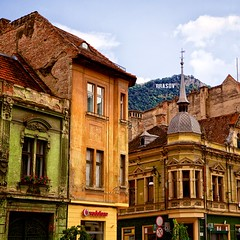 I lift my eyes to the quiet hills (khrawlings) Tags: brasov square street romania buildings old town dome corner sign