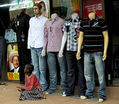 Begging with Mannequins (cowyeow) Tags: poverty africa street city mannequin girl clothing african poor young beggar jeans irony littlegirl uganda ironic kampala begging beg clothingstore