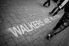 Walkers are practitioners of the city... (Giuseppe Milo (www.pixael.com)) Tags: street ireland people urban blackandwhite bw dublin walking photography photo sony 20mm walkers nex nex6