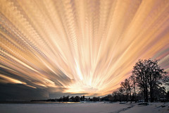 Converging Cloud Trails (Matt Molloy) Tags: trees sunset sky snow ontario canada motion ice lines clouds landscape photography timelapse movement bath trails paths colourful lakeontario lovelife photostack mattmolloy timestack
