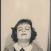 Little girl closes her eyes in a photo booth