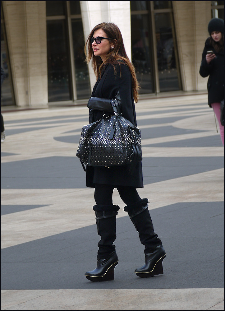 1Z 10w all black cape over leather jacket leggings knee high sculpted platform boots large studded bag sunglasses ol