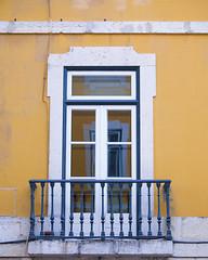 Lisboa window (Mary Susan Smith) Tags: travel vacation reflection tourism portugal yellow holidays lisboa lisbon balcony challengeyouwinner cychallengewinner thechallengefactory tcfwinner