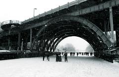 1/100 - Portal to Wintry Fun (Dan Haug) Tags: 2014 100xthe2014edition rideaucanal ottawa skating ef1635mmf28liiusm canon eos 5dmkii unesco heritage flurries snow ice skaters frozen natural bridge arch