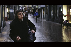 After shopping, time for a smoke (zilverbat.) Tags: portrait people urban woman cinema dutch rain photography town dof bokeh smoke grain thenetherlands citylife streetphotography dramatic streetlife denhaag tourist smoking timelife innercity vibes cinematic portret thehague tabak sigaret nicotine roken urbanlife streetcandid gezondheid filmisch peopleinthecity socialdocumentaryphotography straatfotografie straatfotograaf zilverbat natwegdek vision:plant=0532 vision:outdoor=0869 canonpancakeef40mmf28stm