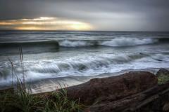 7182 Waves (Paul Rioux) Tags: sun seascape canada beach clouds seaside marine surf waves bc britishcolumbia logs victoria vancouverisland driftwood rays seashore juandefucastrait colwood salishsea esquimaltlagoon coburgpeninsula vision:beach=0647 vision:sky=0769 vision:clouds=0907 vision:ocean=0889 vision:outdoor=0902