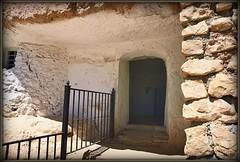 """""""Η πόρτα είναι ανοιχτή ... και τα σκυλιά δεμένα""""   [la puerta abierta .......... y los perros atados] (jose luis naussa (2,5 millones . )) Tags: granada guadix marchal sonice cárcavas imageourtime"""