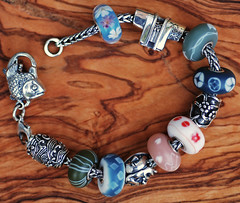 My Japan themed Trollbeads bracelet (chain, fish lock and all the glass beads). (Athanassia) Tags: glass armband silver beads bracelet charms glas kralen haori zilver trollbeads bedels redbalifrog alexcramariuc acakreations