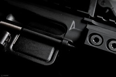 Abstracty Guns (Staufhammer) Tags: abstract macro one nikon key flash low micro pistol guns 40mm nikkor product f28 firearms d300 strobist staufhammer