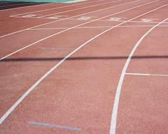 Running Track Lanes (danielfoster437) Tags: competition emptyrunningtrack kodakportra mamiya7 mediumformat portra160 race runningtrack runningtracksurface track trackandfield tracksurface