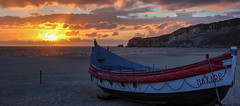 Sunset in Nazar 3 (Xtian du Gard) Tags: portugal nazar boats waterscape sunset outdoor clouds barques seascape plage bracketing fishingboats