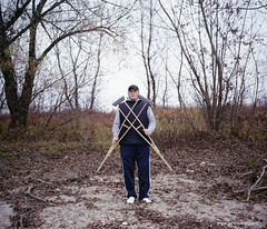 crossed crutches (jrockar) Tags: portrait man guy crossed crutches outdoor winter analogue film mamiya 7 804 fuji pro400h medium format 6x7 jrockar janrockar idiot komarno