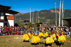Jampey Lhakhang Drup (whitworth images) Tags: dancing buddhist audience himalaya person himalayas carved costume culture bumthang man buddhism travel custom colorful wooden jampeylhakhang men grass festival colourful entertainer color asia symbolism symbolic symbol prayerflags cultural religion hills spectators performance colour people religious entertainment jampeylhakhangdrup grotesque mask event monastery flags dance outdoors bhutan jakar yellow celebration traditional