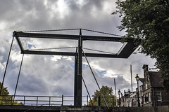 Burning bridges (Wookiee!) Tags: bridge burning boat brug verbranden boot autumn herfst city stad canal kanaal water 35mm lens canon d550 dlsr shertogenbosch den bosch duketown noordbrabant nl the netherlands nederland dutch holland wolken clouds sky lucht rainy regenachtig weer weather photoshop cc2015 wwwgevoeligeplatennl
