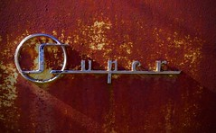Super (StephenReed) Tags: super logo metal rust paint chippedpaint abstract art abstractart weathered nikond3300 stephenreed car chrome rusted