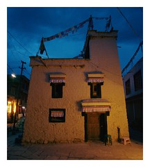 Ladakhi Home (Piers Muiry) Tags: 135 35mm film kodak portra 400 travel adventure landscape ladakh india summer night prayer flags house building architecture roange blue street leh city old