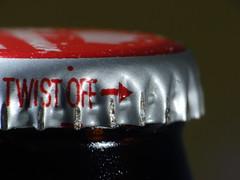 Directional (Quik Snapshot) Tags: directional arrow sony macro macromondays metal dschx200v dcr250 dof red raynox rust bokeh bottle hmm closeup macroscopic beer bottlecap drink twistoff noprocessing nocrop
