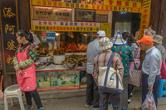 snacks (stevefge) Tags: china shanghai zhujiaujiau watertown people candid men women shop street reflectyourworld food