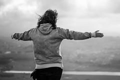 Woman at the summit (esevelez) Tags: bw cantabria liencres picota spain abiertos alto arm arms blackandwhite blancetnoir blancoynegro brazo brazos calido capucha chica high hoodie landscape mountain mujer open pointingat rio river warm wide woman espaa sealando montaa
