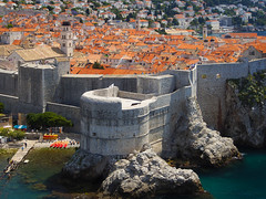 The Walls of Dubrovnik (RobertCross1 (off and on)) Tags: 1250mmf3563mzuiko adriatic croatia dubrovnik em5 europe hrv hrvatska omd olympus battlements beach church city cityscape fortifications landscape medieval roof sea seaport seascape tiles wall water