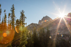 The sun setting over the Tetons (GlobalGoebel) Tags: canonef24105mmf4lisusm canoneos5dmarkiii 24105mm grand teton national park sunset sunstar sun light flare tetoncresttrail backcountry south fork cascade canyon camp wyoming