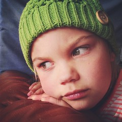 Green (Hueystar) Tags: portrait green window hat smart mobile out square child phone looking 5 knitted iphone