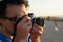 Sam with a Nikon FE2 (Jerry Kooyman) Tags: sunset sun strand zonsondergang sam thenetherlands zon thehague zand kijkduin southholland