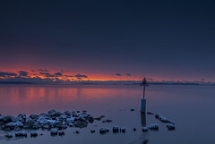 Thunder Bay Marina (Doguu) Tags: winter sunset lake snow canada cold ice water sunrise rocks freezing shore lakesuperior islet thunderbay northernontario silverharbour