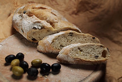 bread with olives close up (brutariabizo) Tags: closeup farmhouse crust bread spread wooden healthy baker oven serbia olive tasty delicious wholemeal homemade bakery organic loaf diet oliveoil slices wholesome baked choppingboard oldfashioned greenolive nutritious fibre blackolive