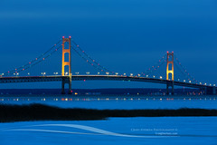 Mackinac Bridge at Blue Hour (Craig - S) Tags: travel bridge winter snow tourism ice reflections midwest michigan lightblur twinkle lakemichigan reflect toll 1957 destination bluehour familyfun icy bigmac upperpeninsula suspensionbridge span mackinacisland lakehuron mackinacbridge stockphoto stignace twinklelights straitsofmackinac tollbridge mackinawcity fineartprint michilimackinac lowerpeninsula mightymac puremichigan davidbernardsteinman mackinacstraitsbridgeauthority