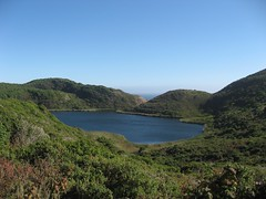 Bass Lake (smenjas) Tags: ocean blue summer sky lake water coast hills clear greenery midday urushiol