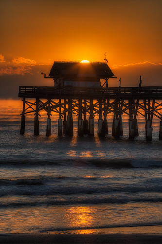 Sun Rising Over Cooca Beach Pier Vertical