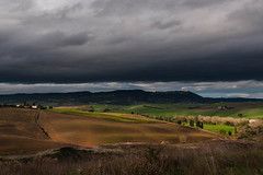 Tuscany Fields of Dreams (alvin.kroon) Tags: italy clouds landscapes tuscany fields farms earthtones vision:mountain=0674 vision:outdoor=0987 vision:sky=099 vision:ocean=09 vision:car=068 vision:clouds=0939