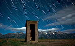 by the light of the moon (Flint Roads) Tags: trees usa mountains night clouds rural stars empty moonlight wyoming np outhouse tetons startrails wy mormonrow moultonouthouse