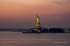 the Statue of Liberty (december.light) Tags: nyc newyorkcity sunset usa water america river lights evening nikon dusk manhattan landmark hudson statueofliberty statenisland citylandscape commuters ellisisland libertyisland ferryboat d5200 sigma85mmf14