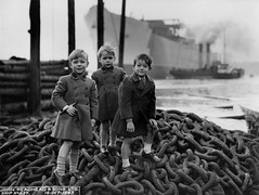 Young guests at the launch of the cargo ship 'Empire Crown' (Tyne & Wear Archives & Museums) Tags: rivertyne southshields shipbuilding johnreadheadsonsltd shipyard cargoship children shiplaunch maritime boys tyneside northeastengland dragchains cute rivers tugboat ships empirecrown empireships ww2 secondworldwar chain pile maritimeheritage industrialheritage shipbuildingheritage blackandwhitephotograph digitalimage johnreadheadsonssouthshields industry launch threeyoungboys bank 16october1943 worldwarii northeastofengland wartime unitedkingdom johnreadhead construction development chimney smoke cylinder blur grain post sky water land timber clothing crease button attentive standing gathering fascinating interesting poignant unusual jsoftley lawe johnreadheadco highwestyard swanhuntergroup britishshipbuilders vessel hainsteamshipcompanyltd stricklineltd princeline sirjamesknott smiling hair