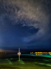Night sky in Jamaica (Robert Bilinski) Tags: jamaica longexposure montego bay starrynight stars clouds yacht caribbean sea canon samyang 14mmf28 robbil robertbilinski nightexposure nightshot nightphoto astrophotography light pollution brilliant