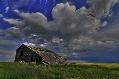 Crumpled under the clouds (Len Langevin) Tags: old abandoned building barn prairie alberta canada weatheredwood forgotten cloud sky nikon d300s tokina 1116