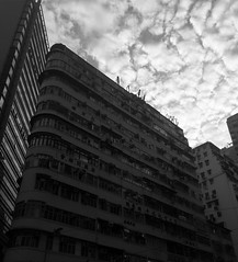 BEAUTIFUL CLOUDS (yphoz) Tags: cloudy clouds hongkong hk wanchai building architecture street streetphotography sky blackandwhite monochrome