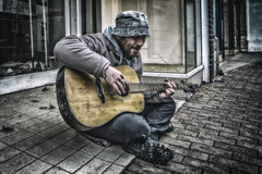 Lost in music, caught in a trap (katatomicuk) Tags: 91365 busker street macclesfield cheshire guitarist