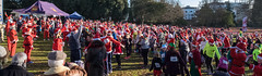 Santas Warm-up (canong2fan) Tags: santasfunrun england fujifilmxe2 pittville fujinonxf1855mm cheltenham gloucestershire europe uk pittvillepark crowd froup people outdoor red elves santa sunshine exercise