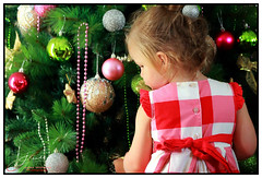 Little Helper (juliewilliams11) Tags: christmas christmastree baubles decoration red pink green silver gold shiny glitter checkered child xmas december bright tree