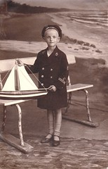 Latvia boy in sailors suit with model sailboat (oldsailro) Tags: park old boy sea summer people sun lake playing beach water pool girl sunshine youth sailboat race vintage children fun toy boat miniature wooden pond model waves sailing ship child with time yacht antique group sailors boom latvia suit regatta mast hull spectators watercraft adolescence keel fashioned